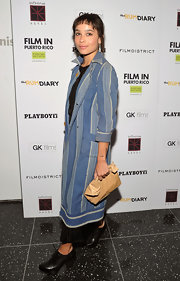 Zoe Kravitz looked relaxed wearing a striped chambray shirtdress over a black ensemble.