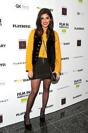 Amanda Setton donned a sexy black mini skirt at 'The Rum Diary' premiere in NYC. She accessorized her look with sheer black tights and black suede platform pumps.