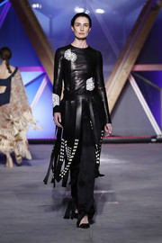 Erin O'Connor was edgy-chic in a fitted black leather top at the Fashion for Relief runway show.