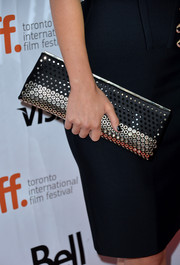 Olivia Wilde added some shine to her all-black outfit with a chic studded clutch when she attended the 'Rush' premiere.