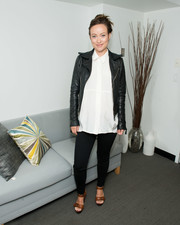 Olivia Wilde layered a white maternity button-down under a leather jacket for the SAG-AFTRA Foundation's Woman event.