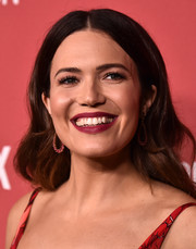 Mandy Moore played up her kissers with some raspberry lipstick.