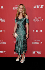 Holly Hunter kept it ladylike in this green cold-shoulder print dress by Prabal Gurung at the SAG-AFTRA Foundation Patron of the Artists Awards.