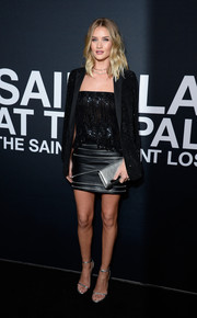 Rosie Huntington-Whiteley sealed off her outfit with a zip-embellished leather skirt, also by Saint Laurent.