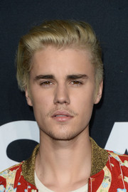 Justin Bieber rocked a cool fauxhawk at the Saint Laurent event.