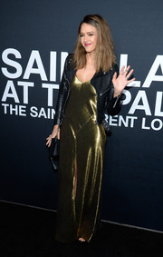Jessica Alba contrasted her sexy gown with a tomboy-chic leather jacket, also by Saint Laurent.