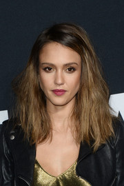 Jessica Alba attended the Saint Laurent show rocking teased hair.