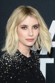 For her beauty look, Emma Roberts went bold with winged red eyeshadow.