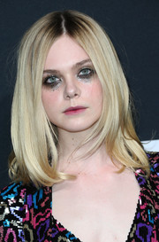 Elle Fanning styled her hair into a center-parted lob for the Saint Laurent show.