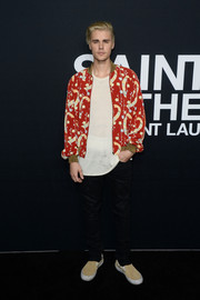 Justin Bieber donned a printed bomber jacket by Saint Laurent for the label's fashion show.