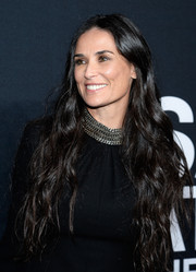 Demi Moore wore her ultra-long tresses down when she attended the Saint Laurent show.