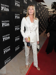 Bo Derek looked very fashionable at the Kirk Douglas Award in a white brocade pantsuit.