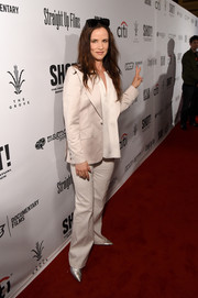Juliette Lewis suited up in white for the premiere of 'Shot! The Pyscho-Spiritual Mantra of Rock.'