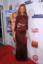Sports Illustrated beauty, Cintia Dicker, looked elegant in a long satin gown with subtle cutouts on the waist.