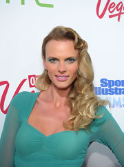 The SI swimsuit model paired her sheer dress with matching teal eyeshadow that rimmed her lower and upper lids.