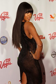 Jessica looked sexy and chic in a black beaded dress at a Las Vegas event. She opted for long and sleek locks with bangs to finish off the look.