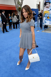 Robin's pleated blue-and-white gingham dress showed off her curves.
