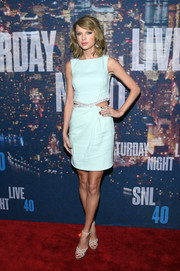 Taylor Swift teamed her cute dress with a pair of nude and gold strappy sandals by Jimmy Choo.