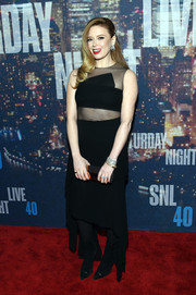 Natasha Lyonne completed her red carpet look with pointy black ankle boots.