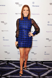 Kate Walsh flaunted plenty of leg in an electric-blue and black mini dress while attending the SPG Hear the Music, See the World performance.