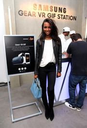 Jasmine Tookes broke up the black-and-white motif with a pastel-blue leather tote.