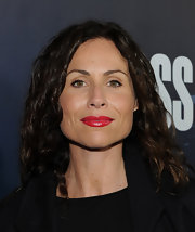 At the 'Boss' premiere, Minnie Driver displayed her smile by wearing a vibrant geranium lipstick. The bright pink-red was super intense with lot of shine.