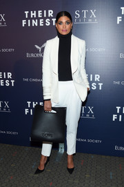 Rachel Roy donned a white blazer with tonal satin stripes around the cuffs for the premiere of 'Their Finest.'