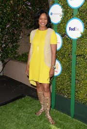Garcelle Beauvais styled her outfit with funky gold gladiator sandals.