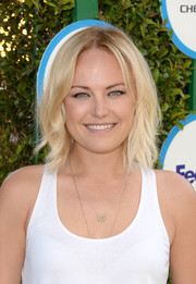 Malin Akerman wore casual, edgy center-parted waves during Safe Kids Day.