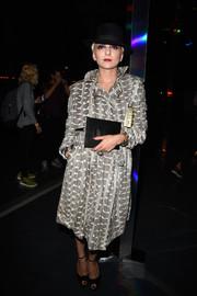 Catherine Baba kept it chic in a gray snakeskin-print coat dress during the Saint Laurent fashion show.