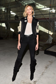 Anja Rubik was sporty-chic in a black and nude varsity jacket by Saint Laurent during the brand's fashion show.