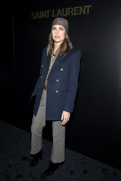 Charlotte Casiraghi teamed her jacket with a pair of gray glen plaid trousers.