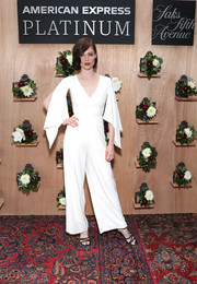 Coco Rocha looked airy in a white jumpsuit with flutter sleeves at the Shop Saks with Platinum benefit launch.