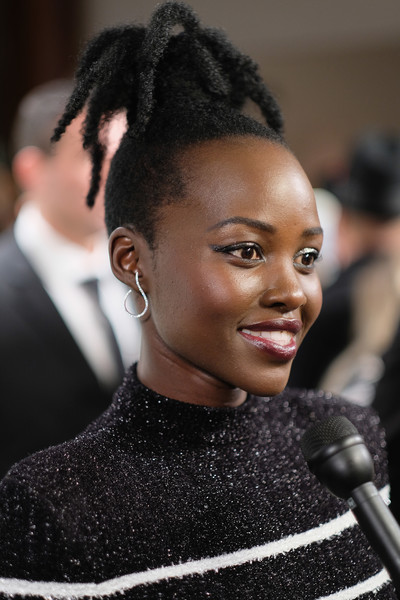 Lupita Nyong'o looked funky with her high ponytail at the Saks celebration.