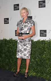 Charlize Theron gave her classic floral print dress a modern edge with black lace-up cutout booties.