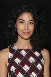 Caroline Issa sported a voluminous curly 'do at the Sally LaPointe fashion show.