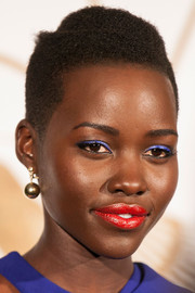 Lupita Nyong'o proved she could work any color when she wore bright blue eyeshadow during the LoveGold party in her honor.
