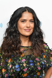 Salma Hayek visited SiriusXM wearing her hair in richly textured curls.