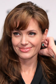 Angelina loves emerald jewelry! For the 'Salt' press conference in Japan the starlet wore green dangle earrings.
