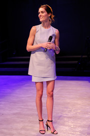 Hilary Rhoda went for mod minimalism in a loose gray top teamed with a mini skirt during the Salute the Runway event.