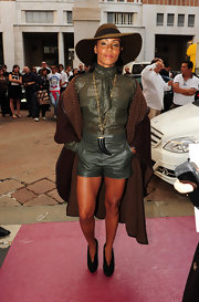 Jada looked ready for fall in her army green leather shorts and matching top.