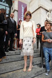 Anna Wintour looked very ladylike in a floral pencil skirt teamed with a twinset during the Salvatore Ferragamo fashion show.