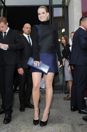 Alice Eve looked fiercely stylish in a blue and black mini dress when she attended the Salvatore Ferragamo fashion show.
