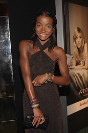 Genevieve Jones carried a black woven leather box clutch to attend 'Attimo' fragrance launch party.