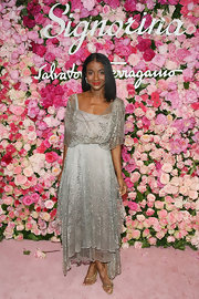 Genevieve Jones looked radiant in a shimmering silver layered asymmetrical evening dress at the launch of Signorina.