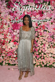 Genevieve Jones attended the launch of Signorina in nude sparkling heels.