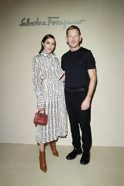 Olivia Culpo looked demure in a printed pussybow blouse by Ferragamo during the brand's Fall 2019 show.