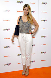 Stacey Solomon paired white Capri pants with a print camisole for a breezy look during the 'Sam & Cat' premiere.