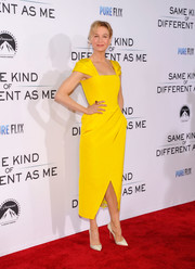 Renee Zellweger dazzled in a bright yellow cap-sleeve cocktail dress by Carolina Herrera at the premiere of 'Same Kind of Different as Me.'