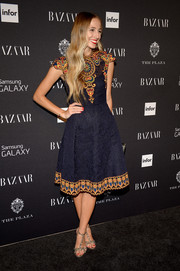 Harley Viera-Newton kept it dainty at the Harper's Bazaar Icons event in a lace dress with colorful bodice and hem embroidery.